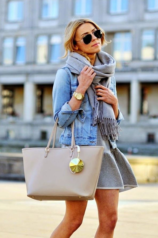 a blonde girl wearing a denim coat and beige bag
