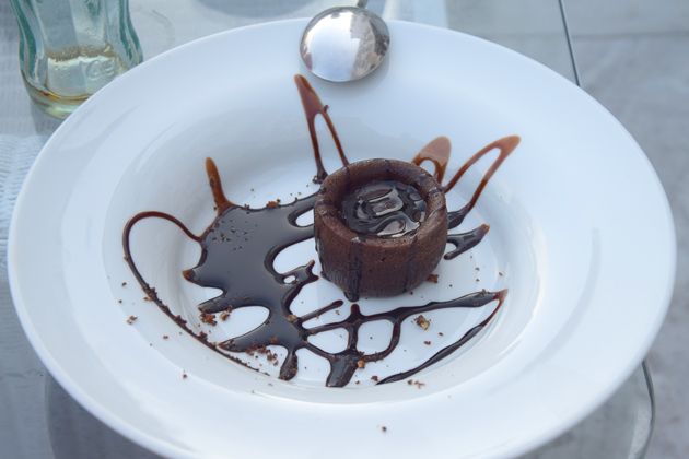 a plate and a chocolate dessert at a restaurant in Santander, Spain