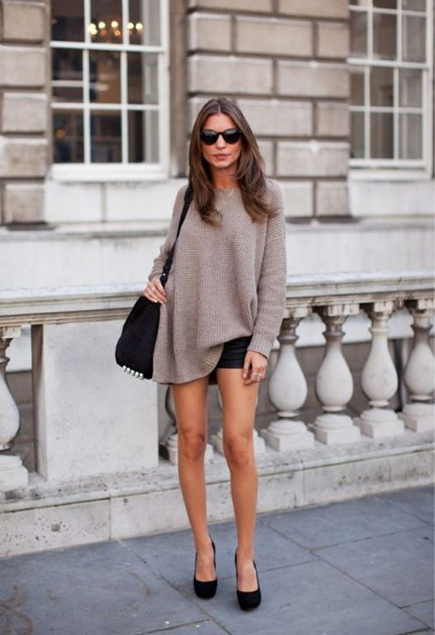 a girl on the street style wearing shorts and long sweater. She has ankle boots and she look great