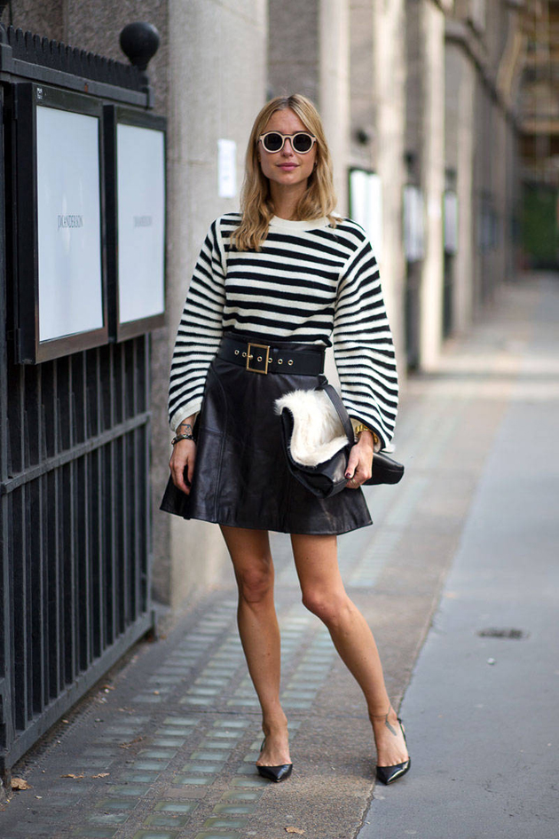 girl wearing leather skirt and stripes