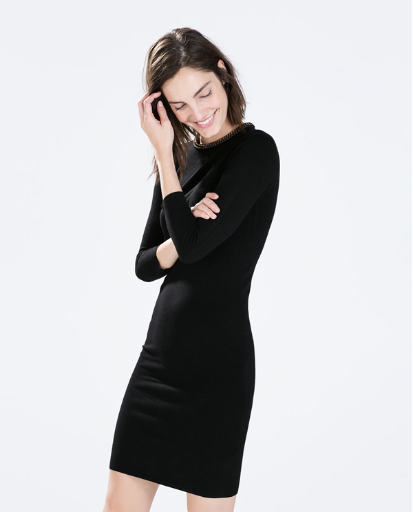 a woman wearing a black dress from Zara.