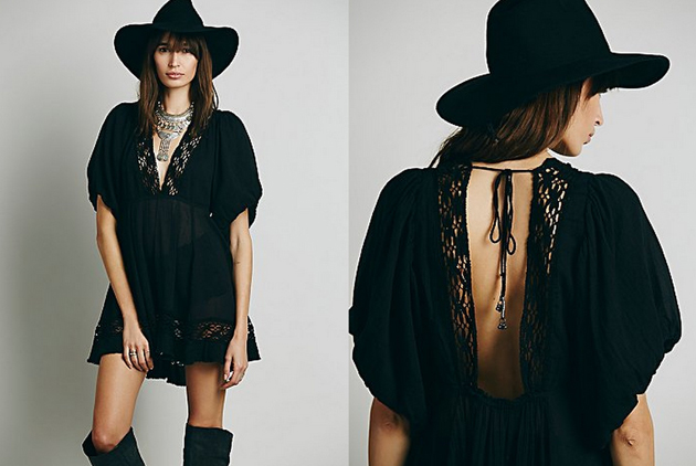 A woman wearing a boho black dress from Free People and Alaia. She has a boho romantic style. She is wearing a black hat which is very trendy this autumn.