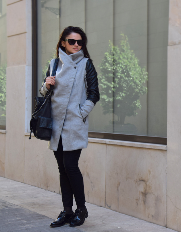a lady wearing great shoes and grey coat