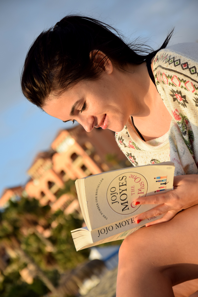 girl reading the book one plus one on the beach in tenerife