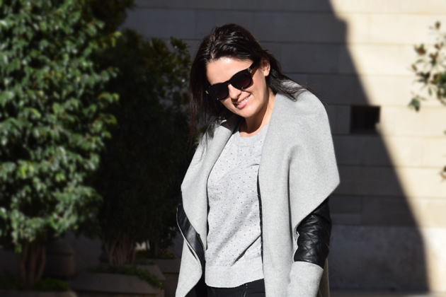 woman wearing a grey sweater and black pants for office