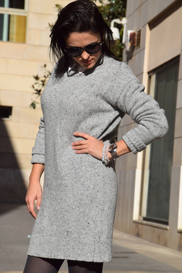 elegant woman wearing a Zara grey dress to the office