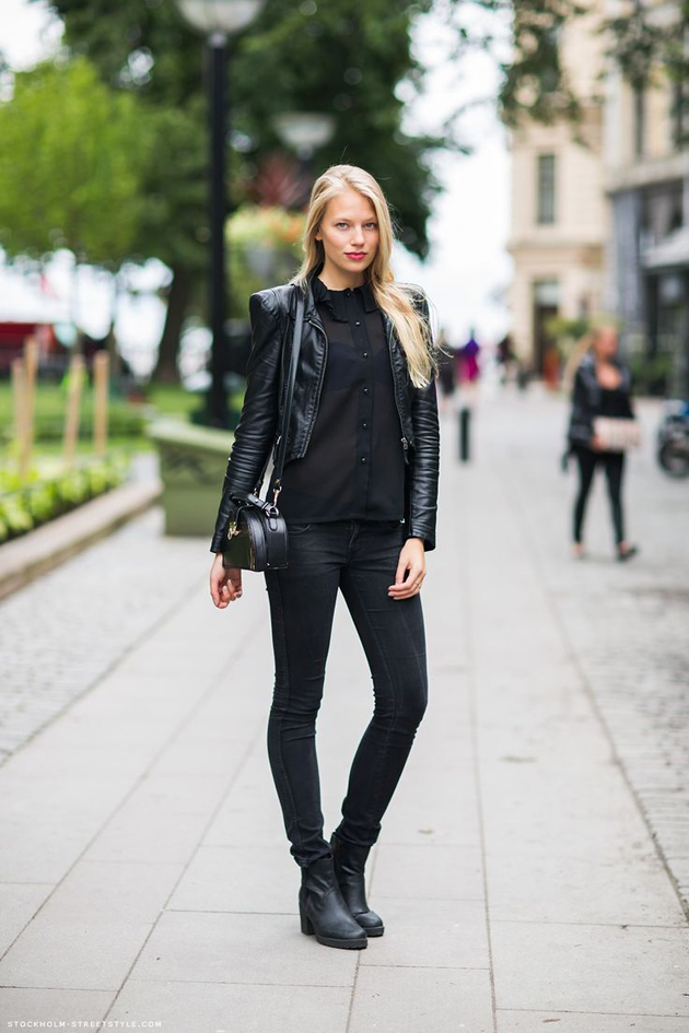 woman wearing only black in a very chic outfit