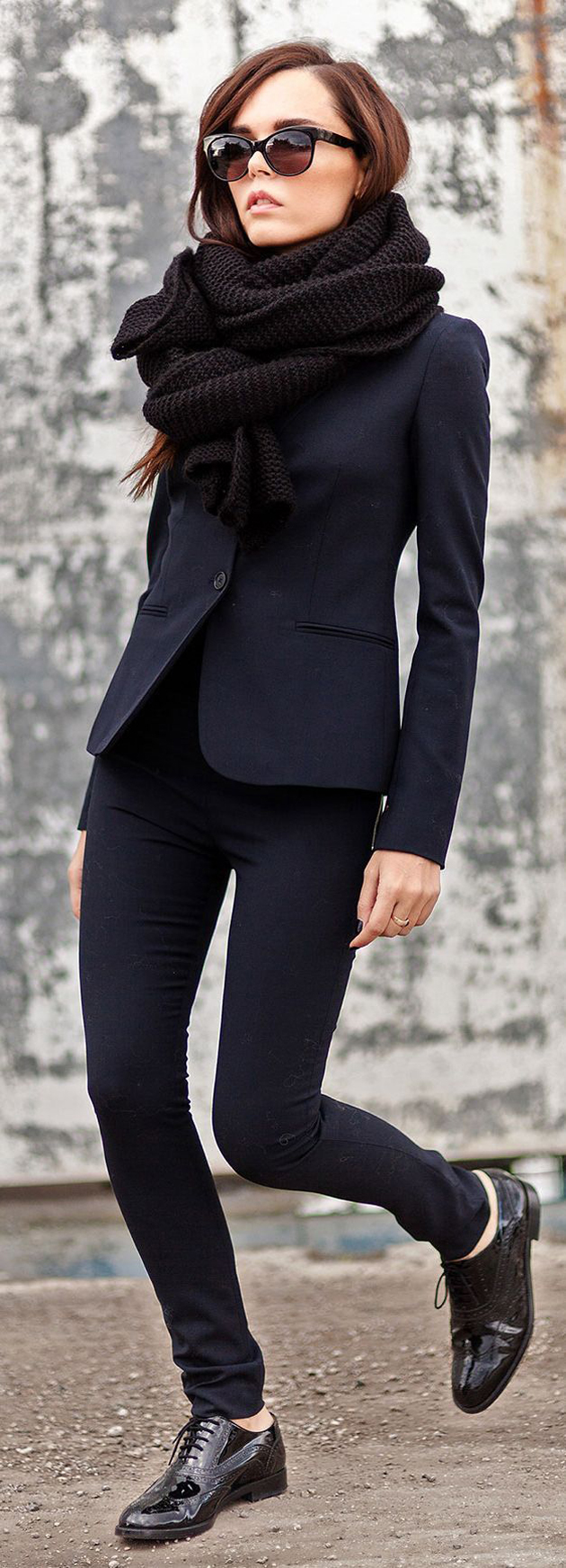 woman wearing a great black suit to office