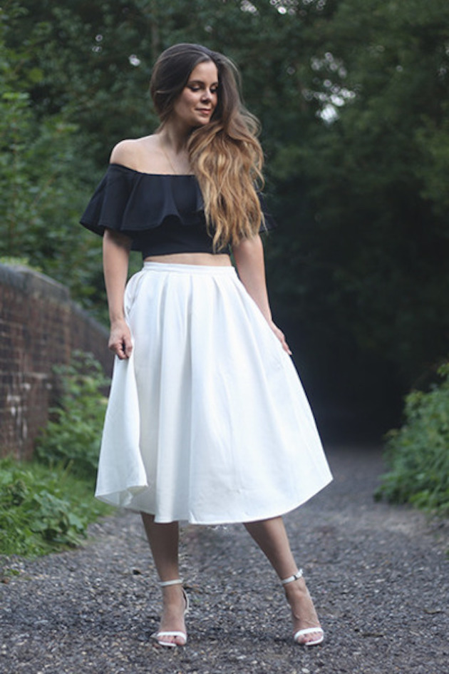 lady in a white skirt and off shoulder black top