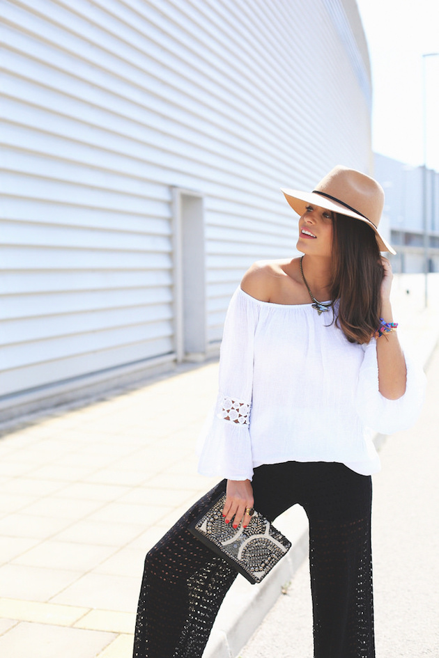 girl in an off shoulder white blouse