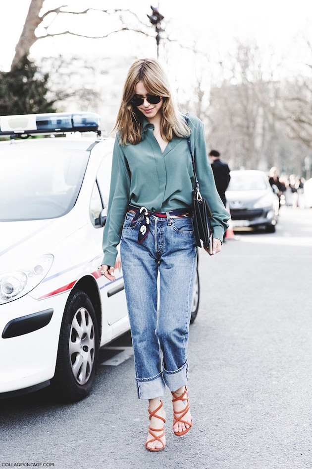 a fashion blogger wearing blue jeans and scarf as a belt