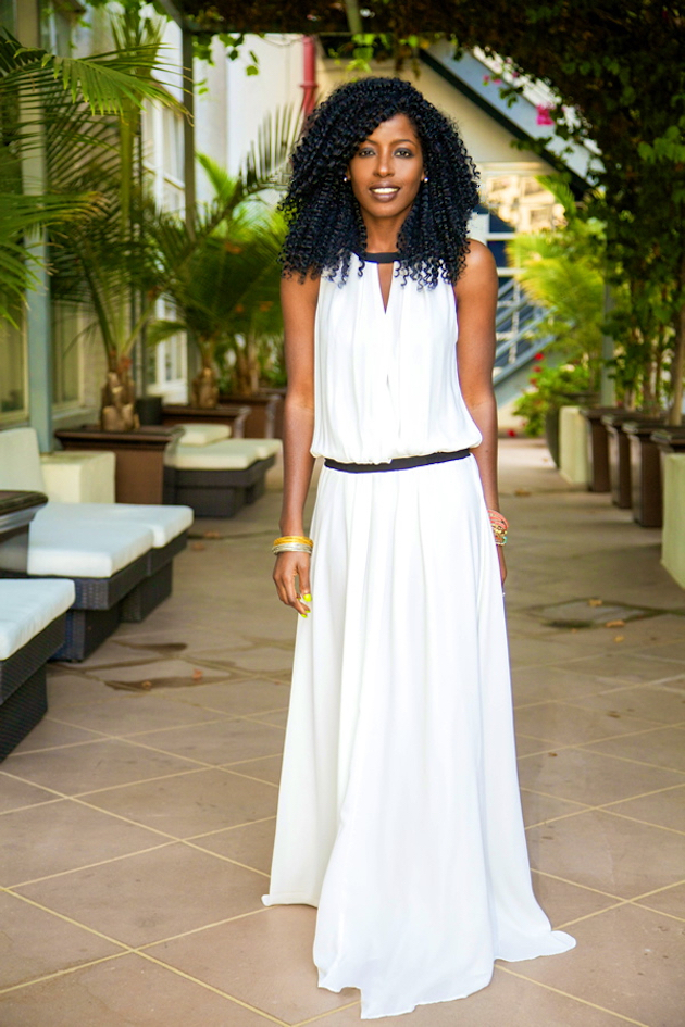 a womna wearing white long maxi dress
