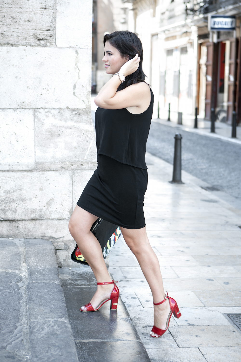 lady wearing a black dress and red shoes