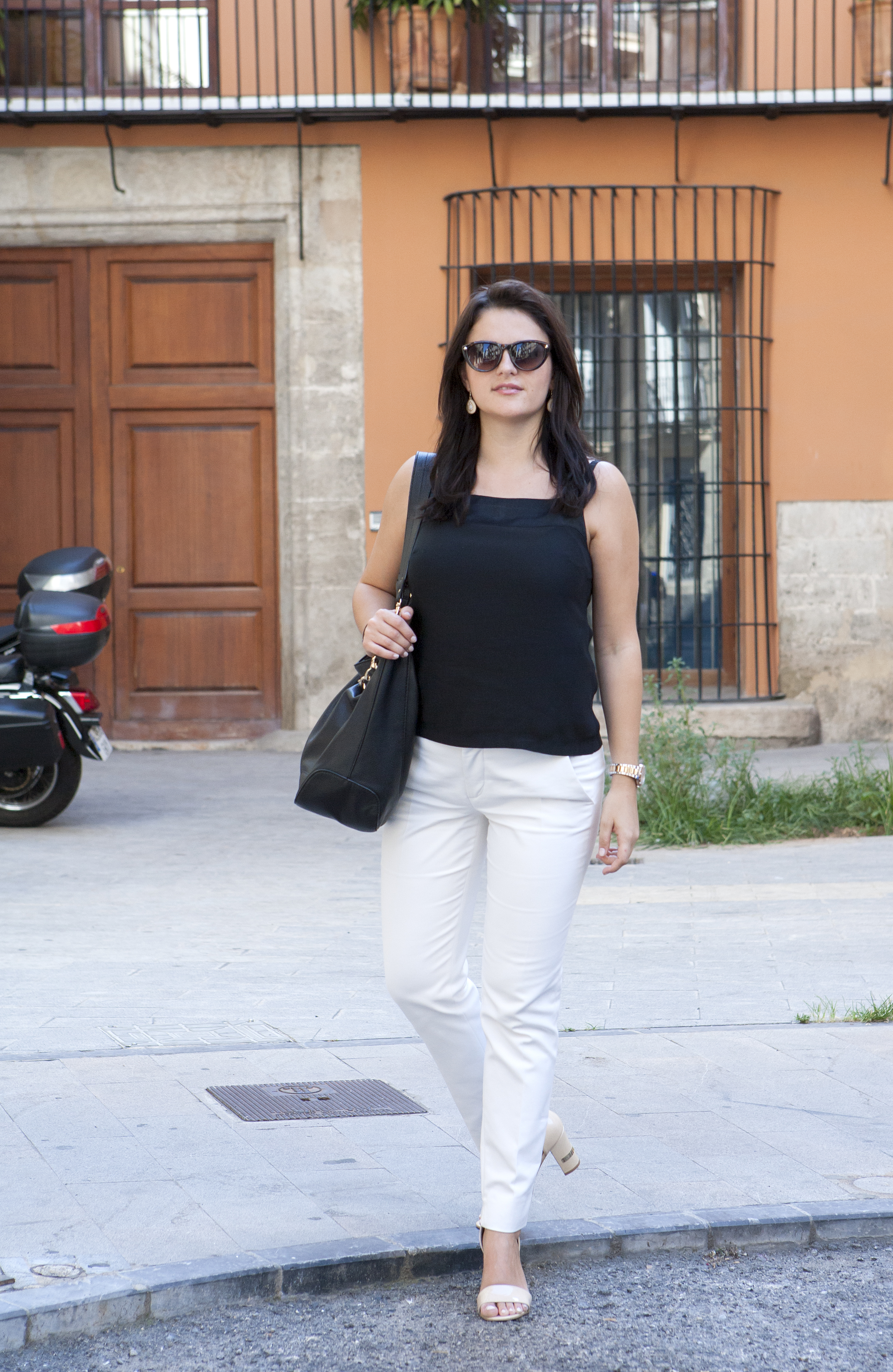 office outfit for summer in white pants and elegant black top