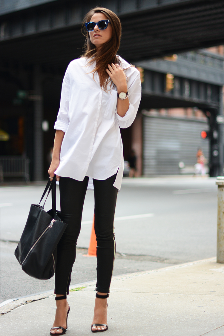 woman wearing white shirt and black pants