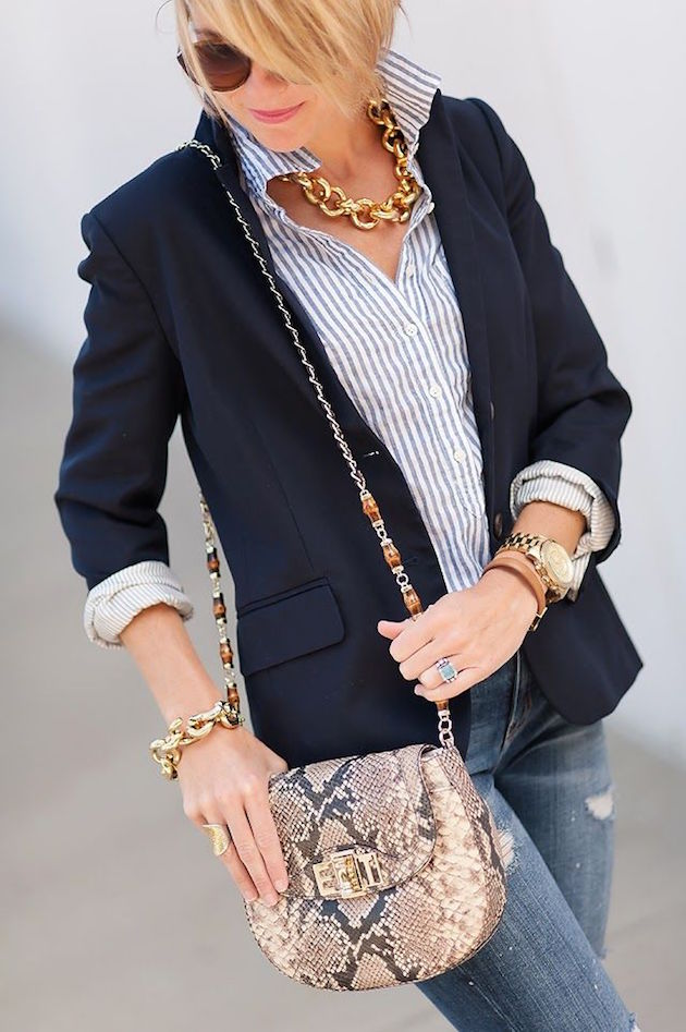 elegant outfit with a small bag with python print