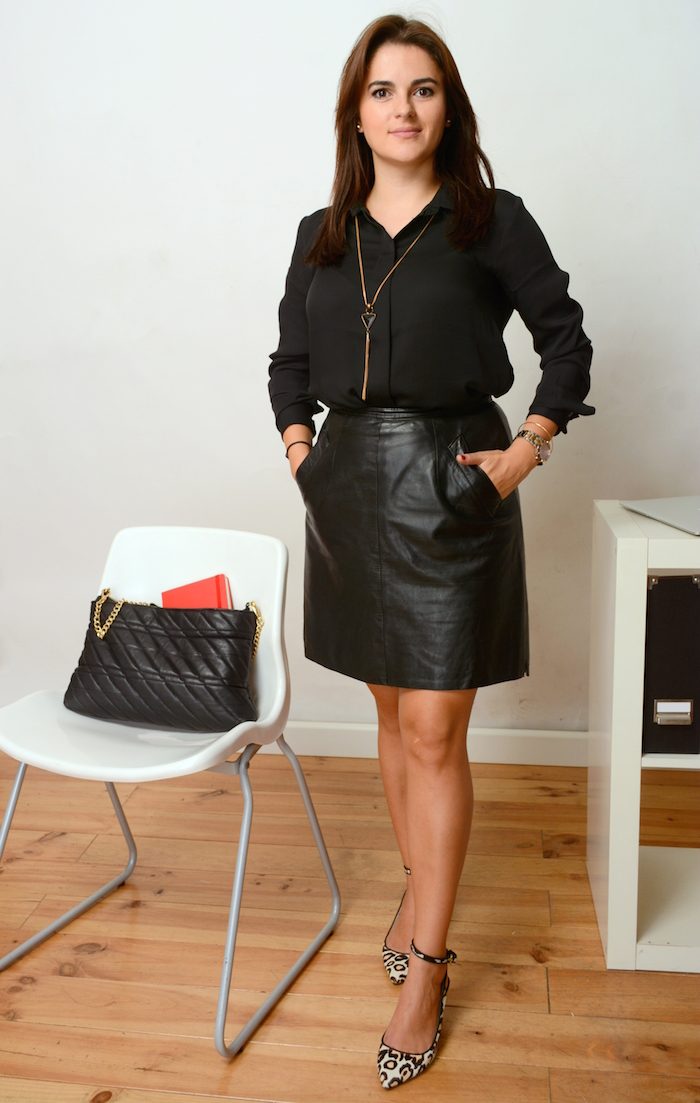 business woman wearing a leather skirt and all black to office
