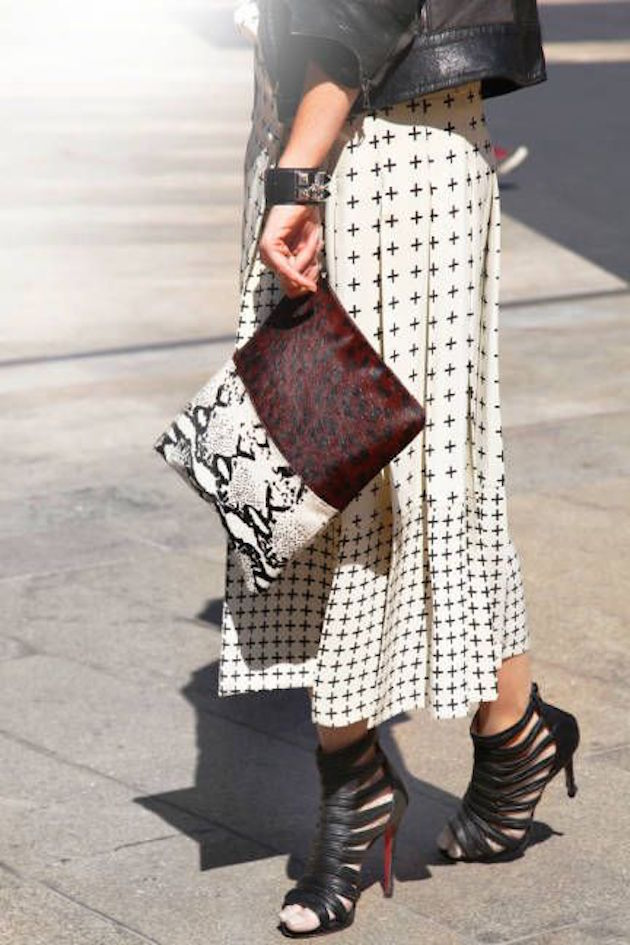 lady wearing an animal print clutch