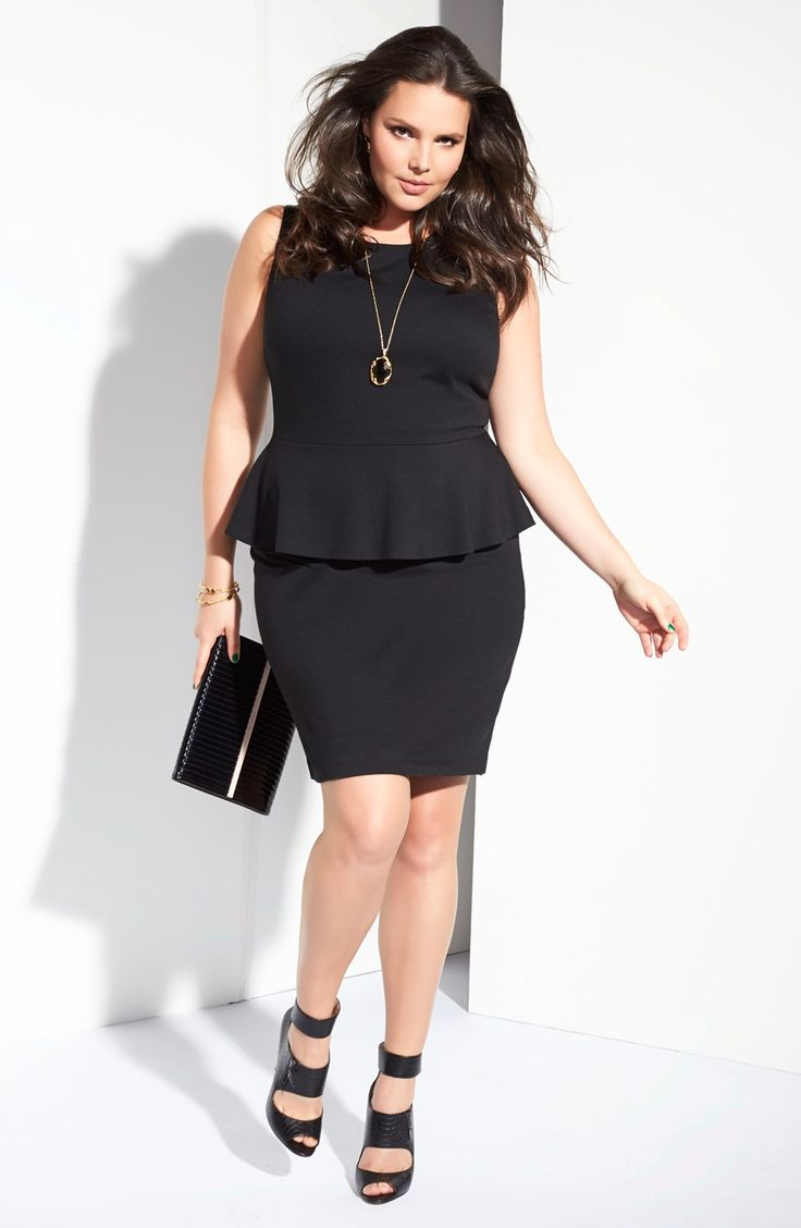 An elegant woman wearing a black dress and having an hourglass body shape
