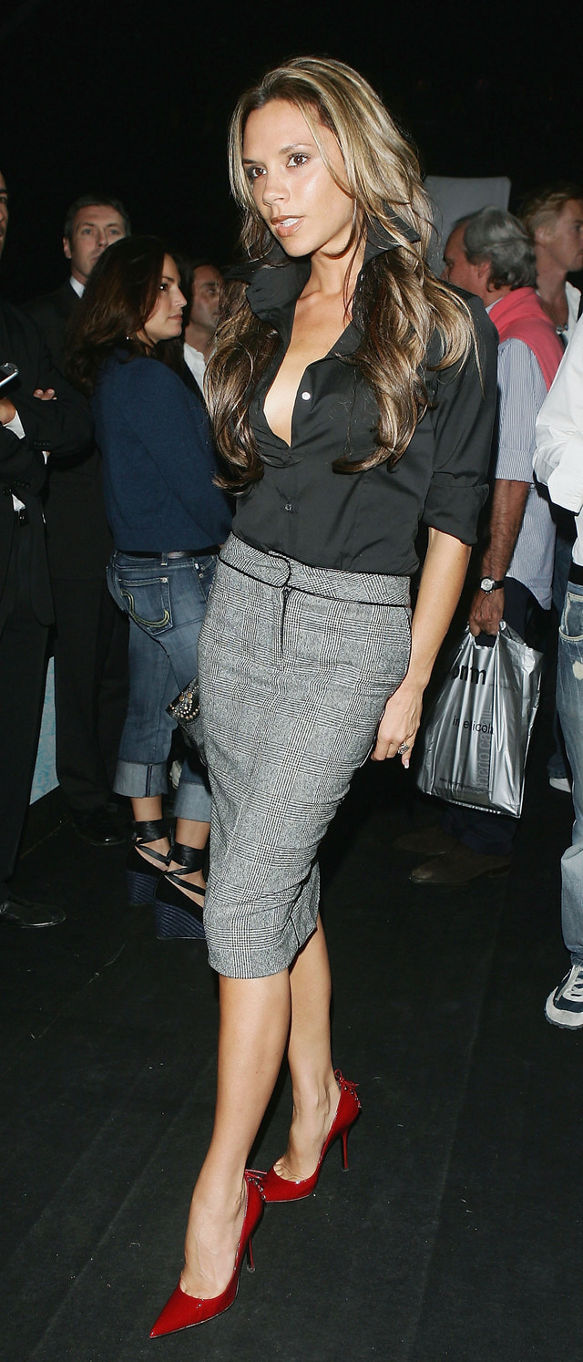 Victoria Beckham wearing a grey midi pencil skirt