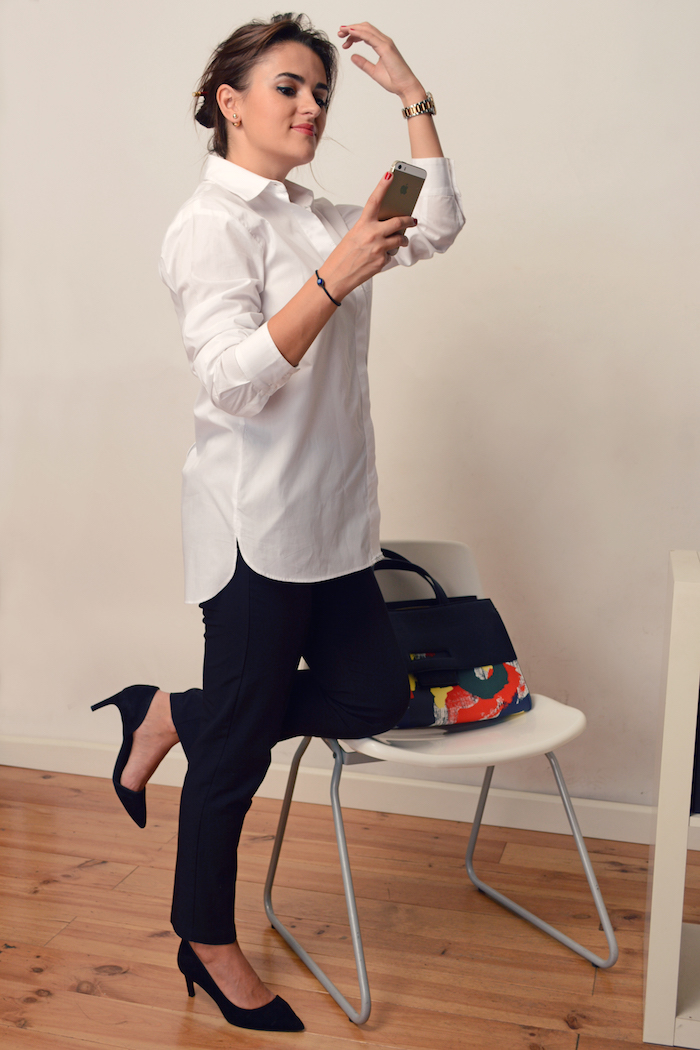 woman wearing an elegant white button down to office