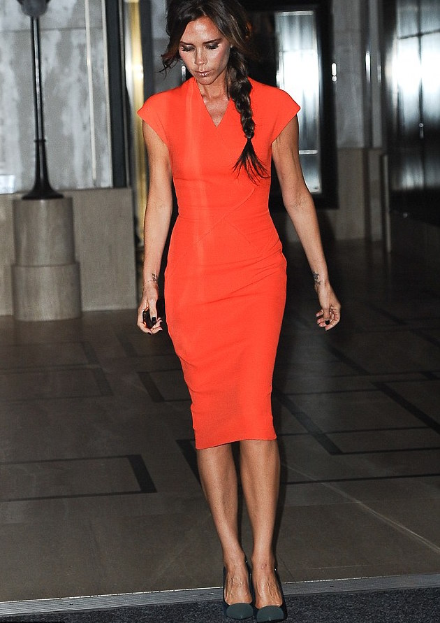 victoria bekcham in an orange dress