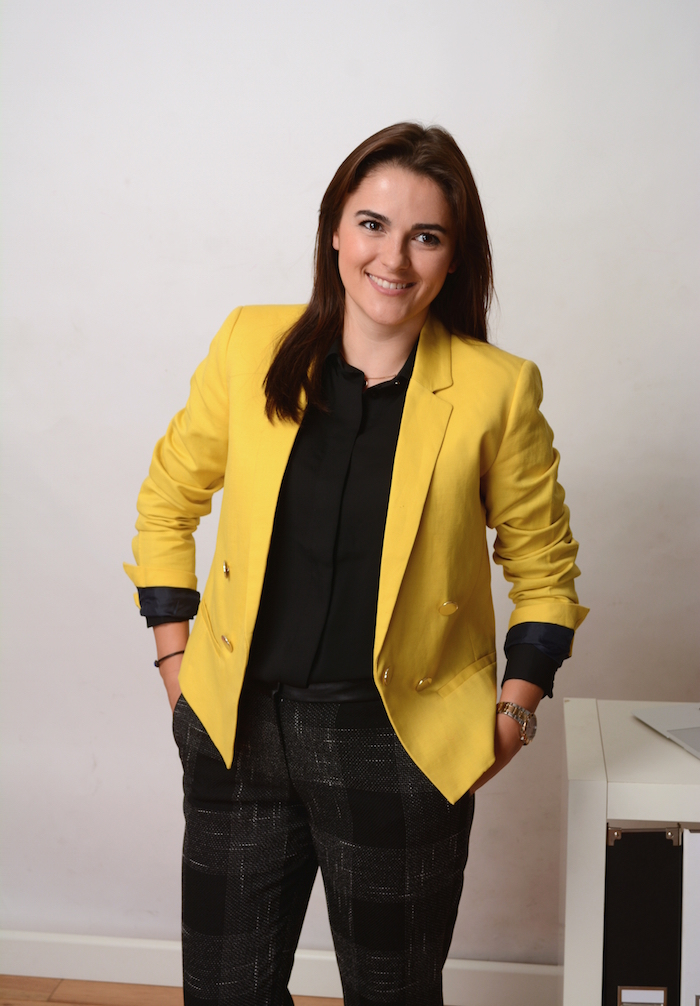 a woman wearing an elegant outfit for office