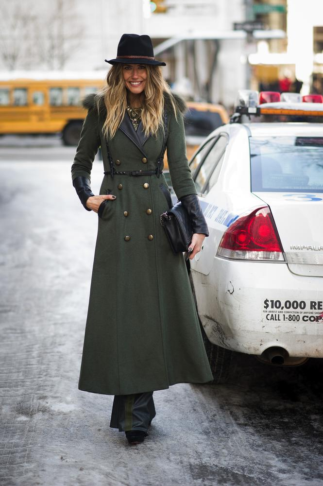 Woman wearing a long military inspired coat