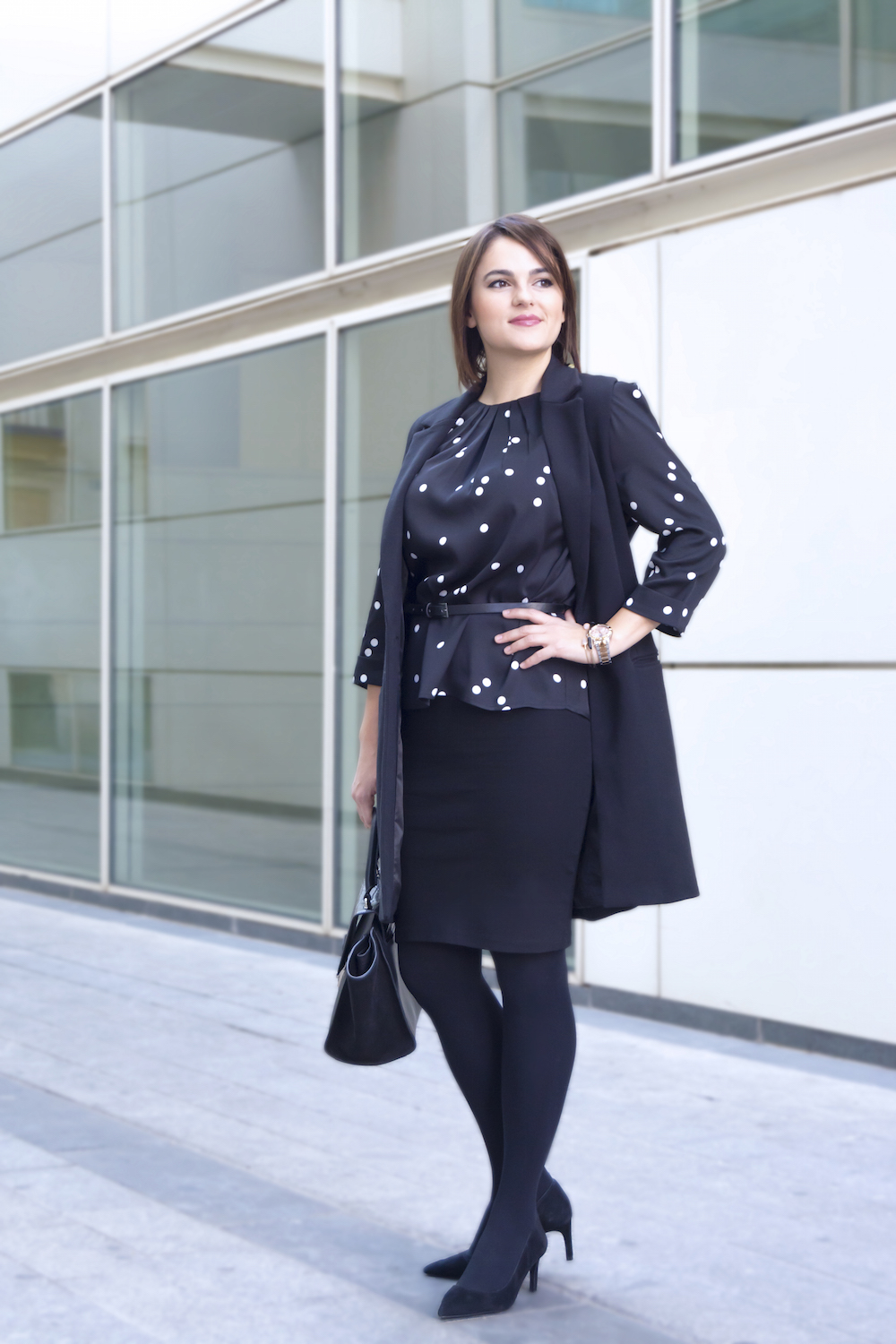 lady wearing a black pencil skirt and black coat