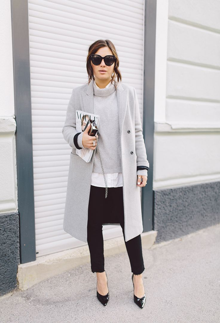 Business woman wearing Grey-Coat-Grey-turtle-neck-skinnie-black-trousers-and-black-pumps.-Chic-and-classic.