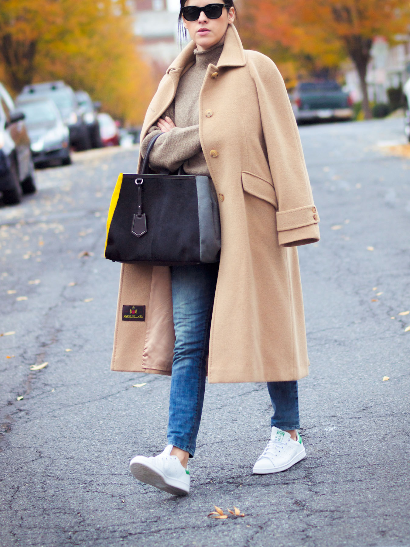 beige long coat with sneakers