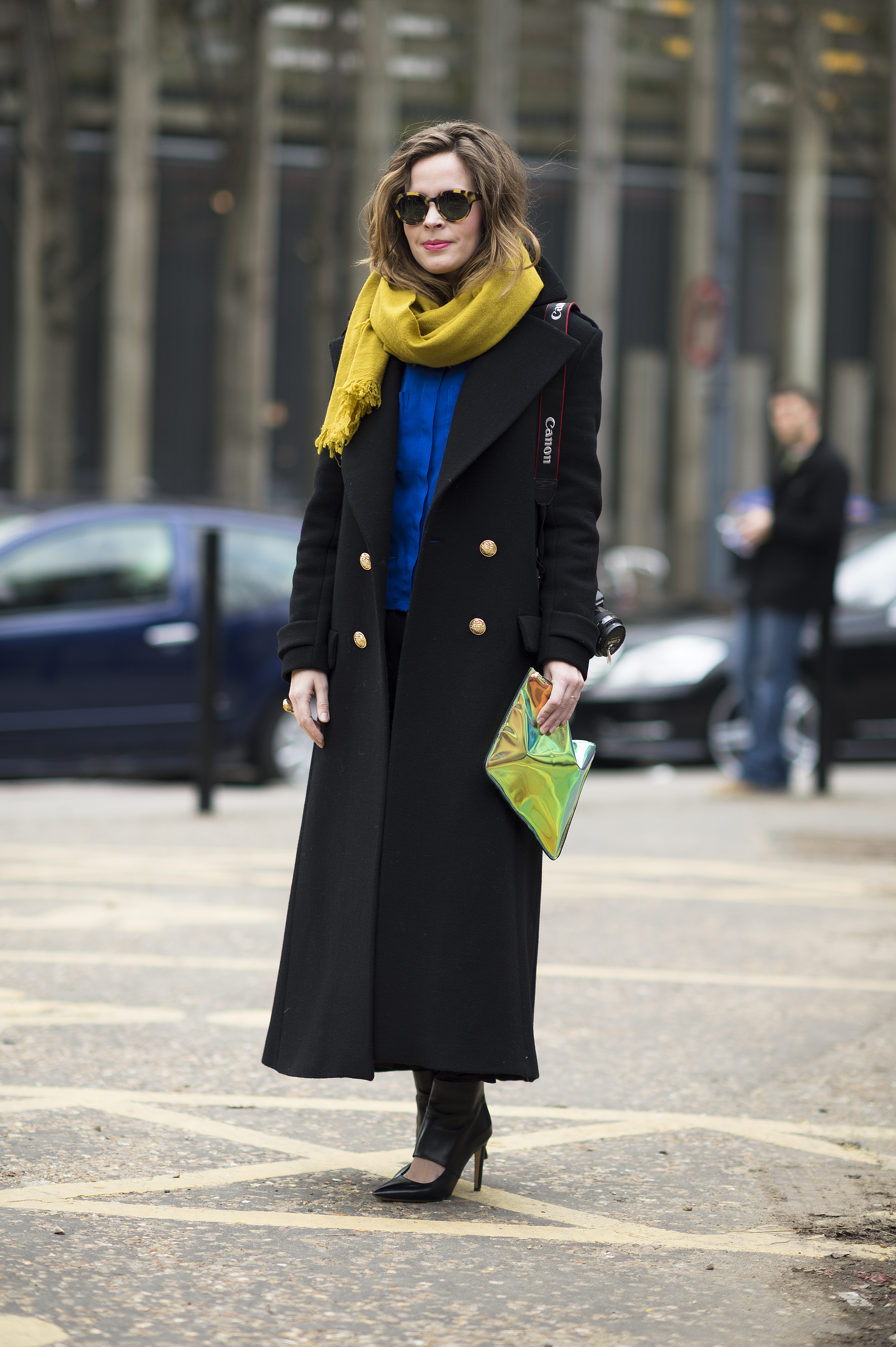 Pops-bright-color-against-full-length-military-style-coat-got