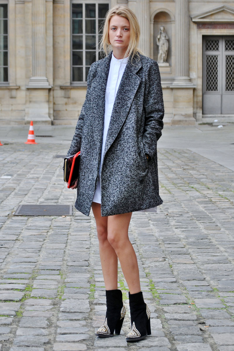 girl wearing a minimalist coat