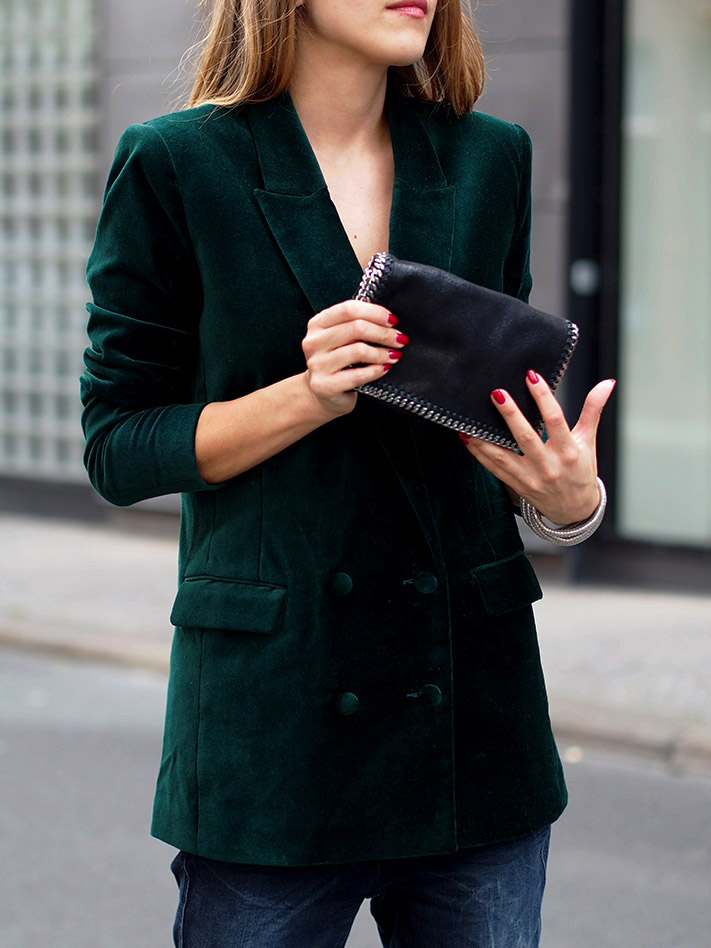 woman wearing a green velvet blazer
