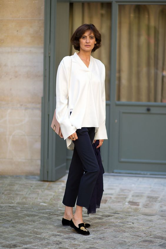 french stylist wearing silk white shirt and black pants